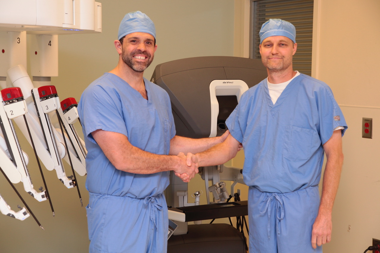 Dr. Brent Sharpe and Dr. Froylan Gonzalez after performing robotic procedures.