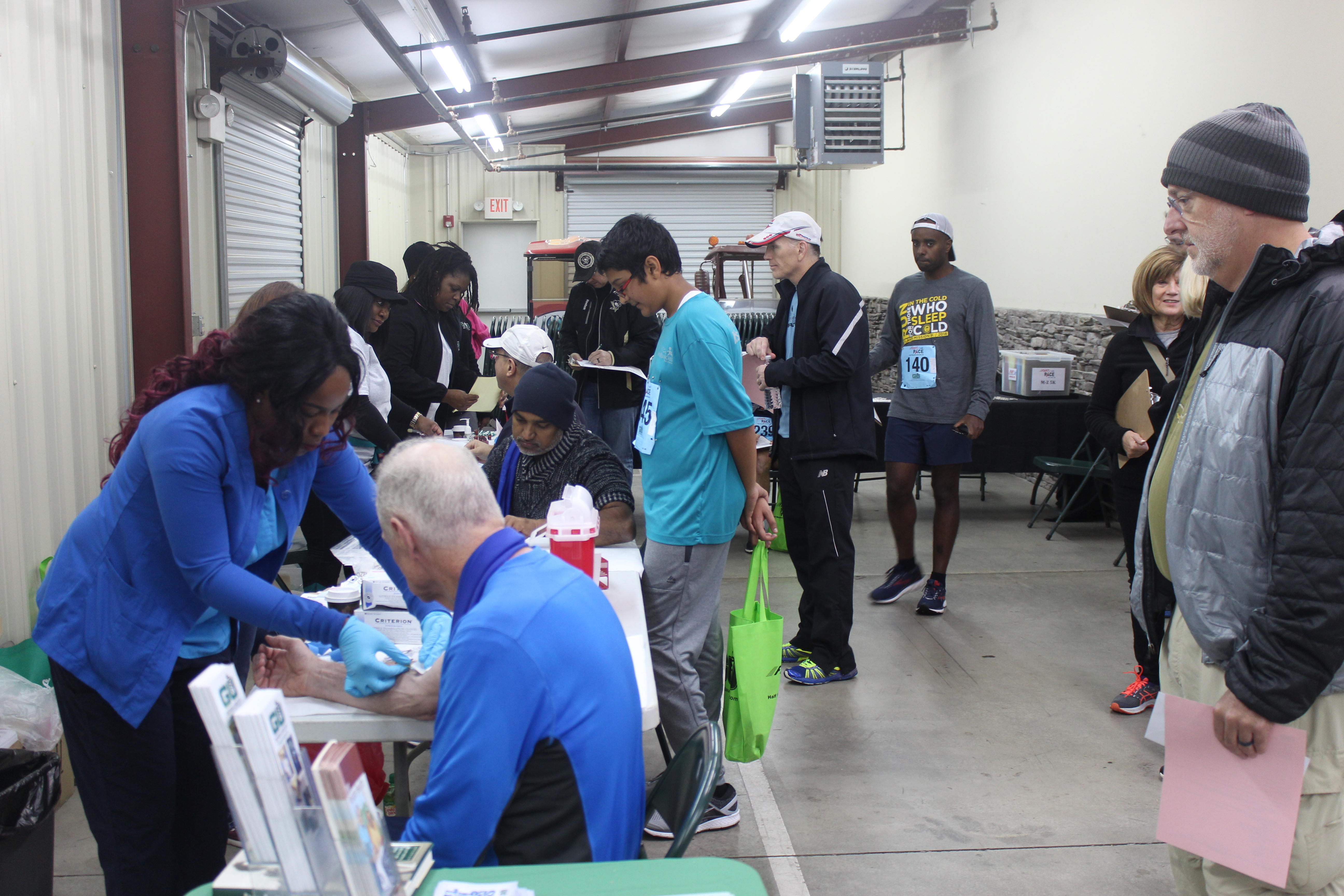 Photo of the F.A.S.T P.A.C.E event, GU nurses getting the prostate cancer readings for participants.