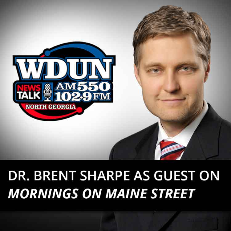 Dr. Brent Sharpe with WDUN logo