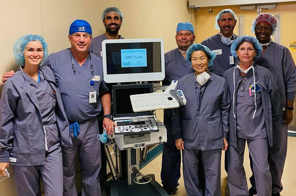 Georgia Urology physicians stand beside aquablation machine.