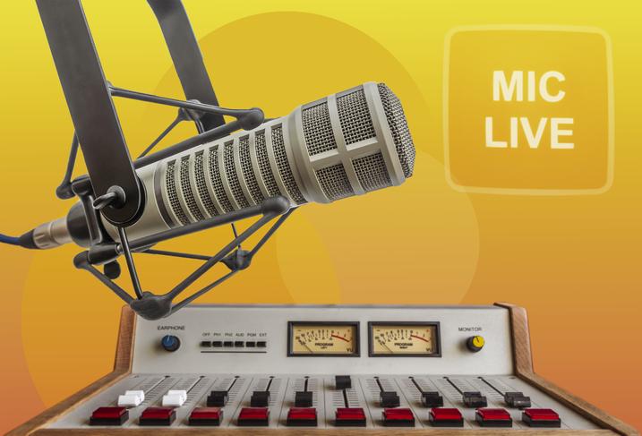 Professional microphone and audio mixer in radio studio.