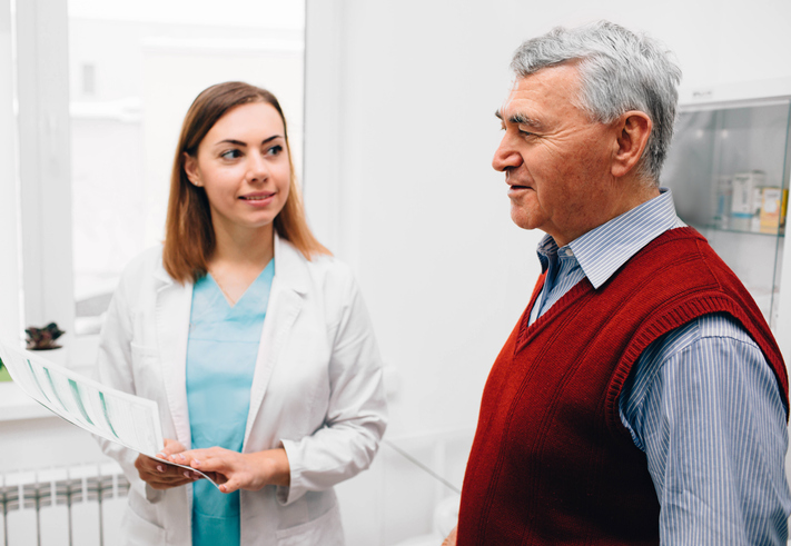 elderly man consults with his doctor in clinic, discussing Urethral Stricture.