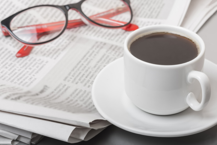 The concept of news. Newspaper on the table, glasses. Coffee break.
