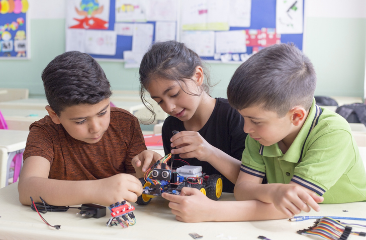turkish student group are developing the robot in the classrom.