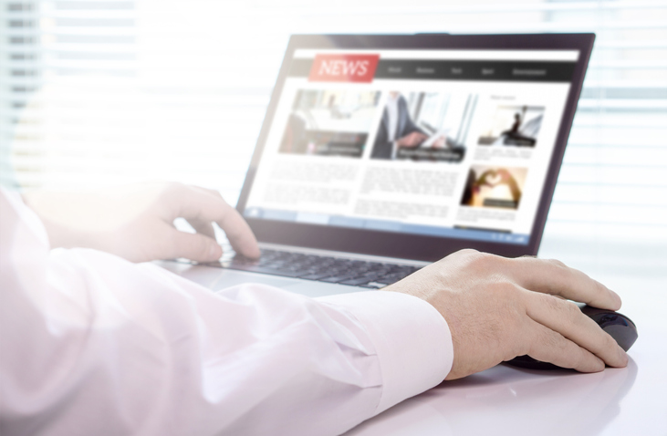 Reader, journalist or writer with online news article on laptop screen. Digital media portal mockup. Latest daily press. Editor writing or person using electronic newspaper or web magazine service.