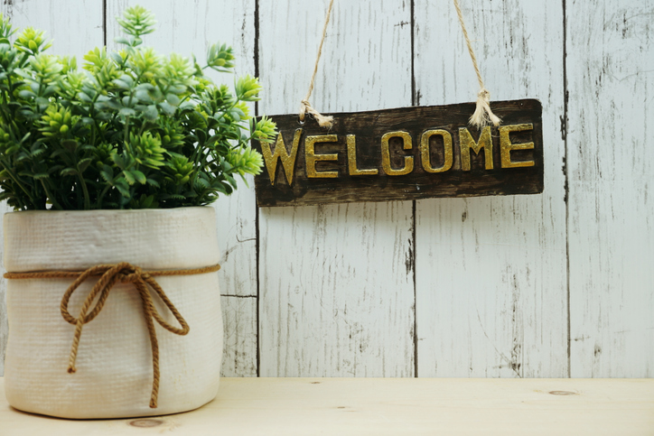 Welcome sign and home decor with space copy background.