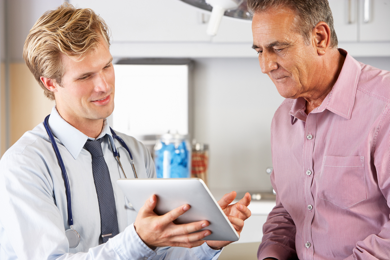 Urologist discussing Peyronie's disease with patient.