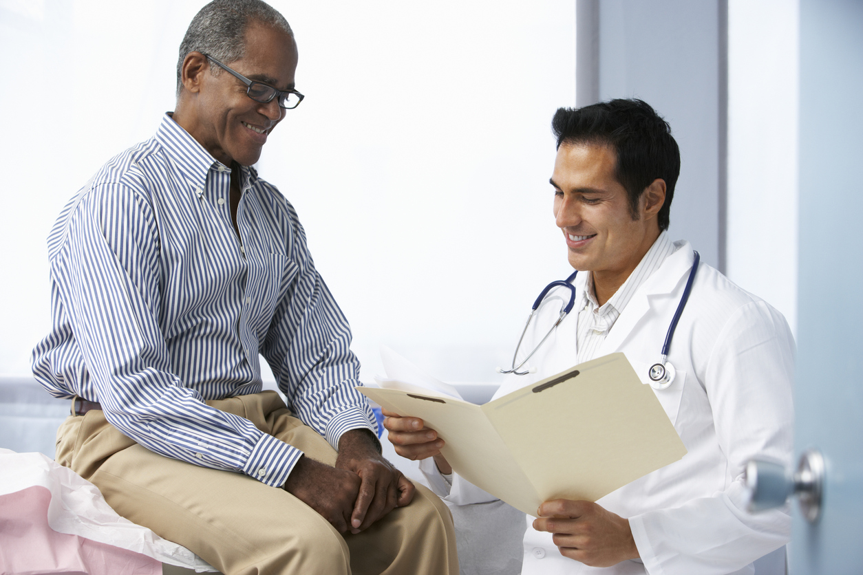 Happy patient discusses erectile dysfunction treatment options with Georgia Urology physician.