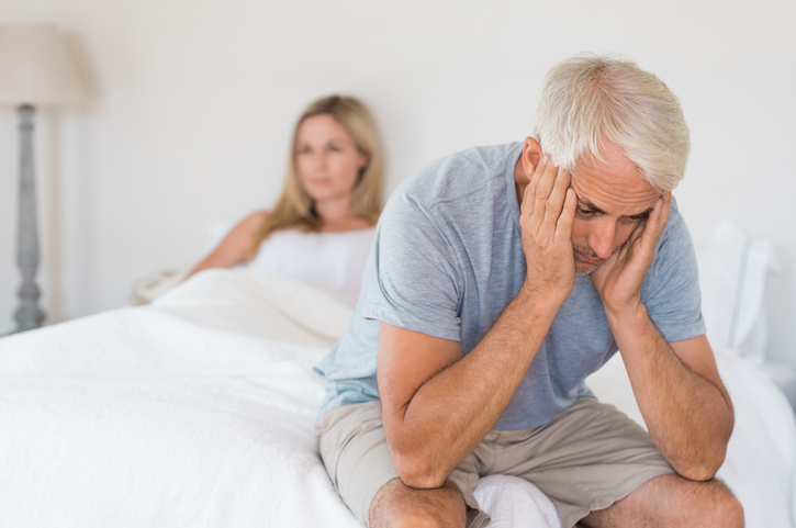Upset mature couple ignoring each other. Close up of a worried senior man in tension at bed. Senior couple angry with each other after a fight after dealing with erectile dysfunction.