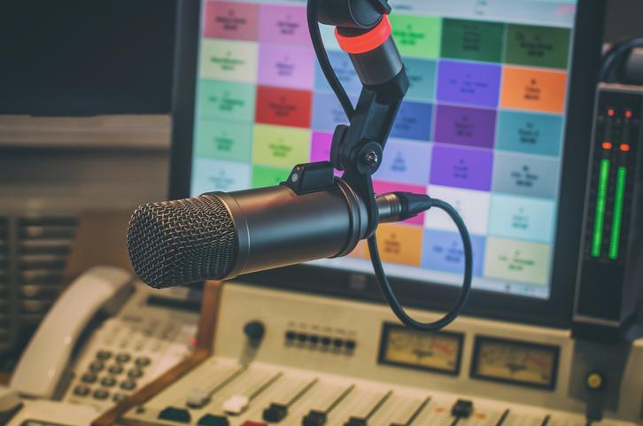 Microphone and audio mixer in the radio studio.