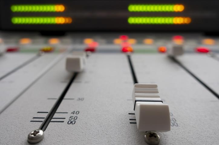 sound mixer in radio studio.