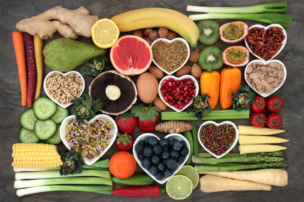 spread of healthy fruits and vegetables on table, food to prevent prostate cancer